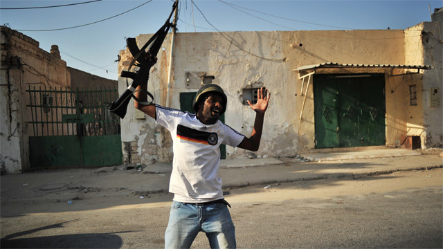 Time to disband Libyan rebel forces