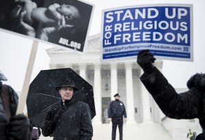 People who support Hobby Lobby's choice to withhold contraceptive healthcare coverage from their employees rally outside the US Supreme Court March 25, 2014 in Washington, DC. (Getty Image).