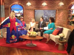 "Amy shows off her wingsuit on ""New Day."""