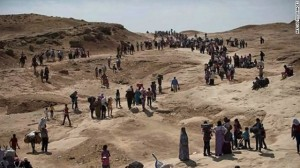 Displaced Iraqis seek refuge Monday after the Islamic State took their hometown