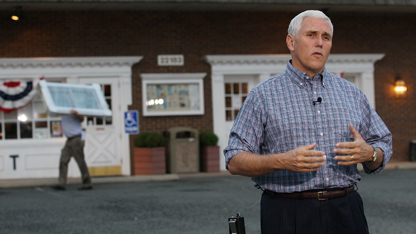 Pence touts flat tax in economic address