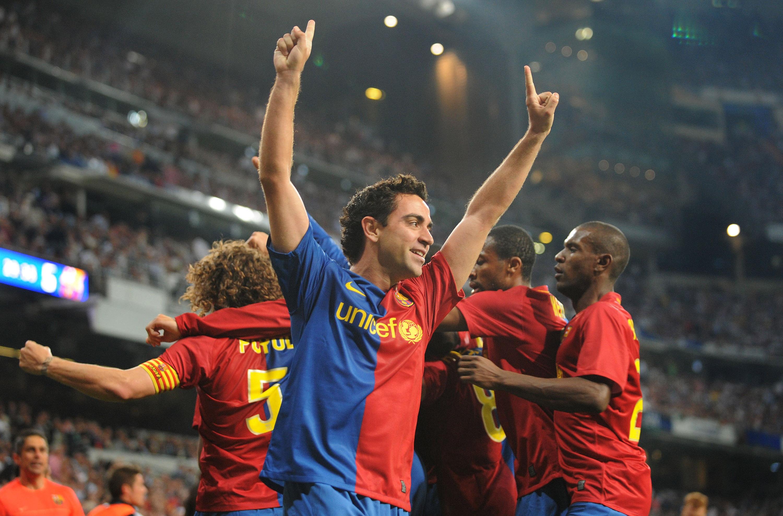 Xavi of Barcelona celebrates after Gerard Pique scored Barcelona's sixth goal against Real Madrid.