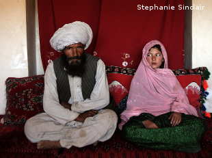 Faiz, 40, and Ghulam, 11, sit in her home prior to their wedding in the rural Afghnanistan on Sept. 11, 2005.