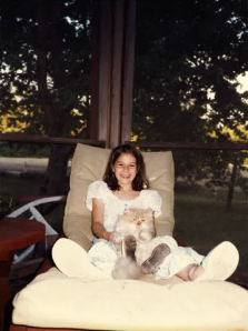 A young Erin Burnett with her cat, Andy.