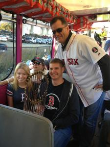 Adrianne Haslet-Davis & Adam Davis hold the World Series trophy, with Red Sox manager John Farrell, as part of the parade to celebrate the World Series victory. SOURCE: Adrianne Haslet-Davis/Adam Davis