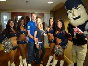 Adam Davis & Adrianne Haslet-Davis pose with the New England Patriots' cheerleaders at the season's opening game. SOURCE: Warrior Wishes​